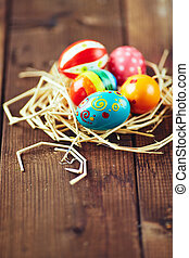Holiday symbols - Easter painted eggs in nest