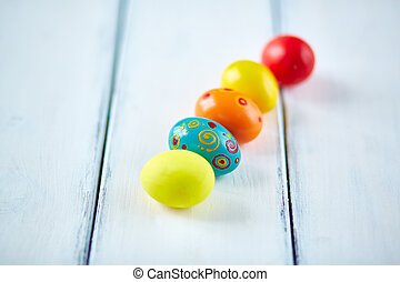 Row of Easter eggs - Easter symbols on white painted wooden...
