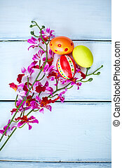 Eggs and flowers - Easter painted eggs with purple orchids