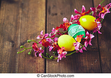 Eggs in orchids - Easter painted eggs inside orchid wreath