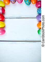 Easter frame - Frame of Easter eggs on white painted wooden...