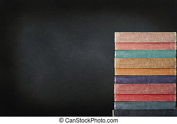 Stack of Books with Chalkboard - Education concept. A tall...