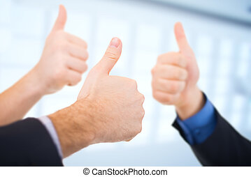 Businessmen gesturing thumbs up Business concept