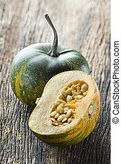 Pumpkin - Beautiful halved pumpkin close up shoot on wood