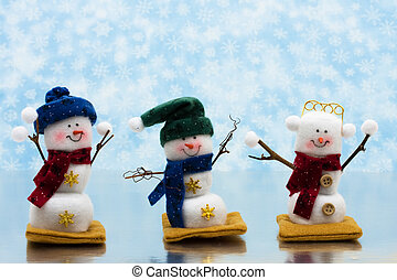 Happy Holidays - Three snowman sitting together on a icy...