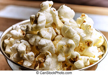Cropped Popcorn in a silver bowl ov - Close-up cropped image...