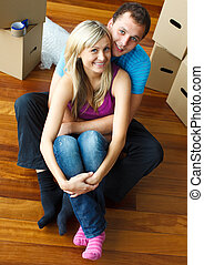 Couple happy with a move - Young and happy couple sitting on...