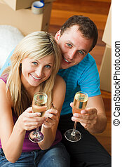 Couple celebrating new home - Happy couple celebrating their...