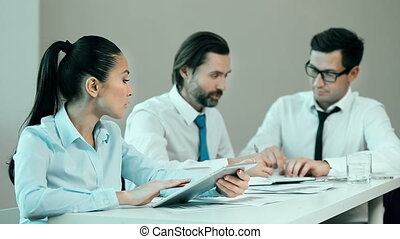 Financial Analysis - Close up of three business people at...