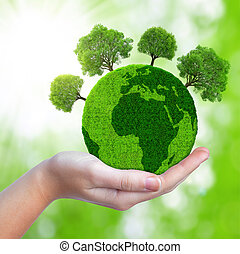Green planet with trees in hand.