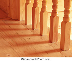 Baluster - Wooden baluster at the bottom of a staircase