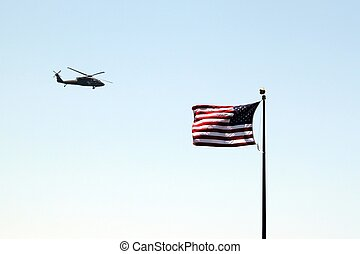 usa flag helicopter - USA helicopter flying by a US flag...