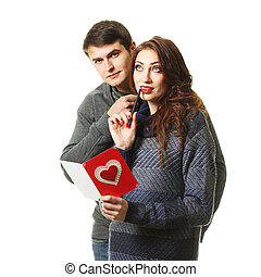 beautiful couple with a card on Valentines Day