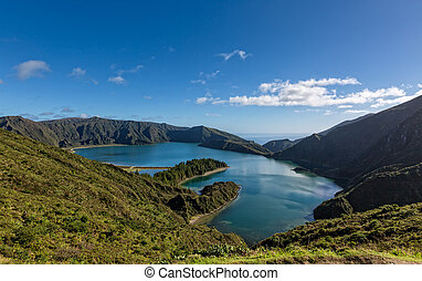 Beautiful view of the Lake in Crater Volcano Covered with Forest