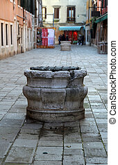 marble well in calle of Venice - ancient marble well in...