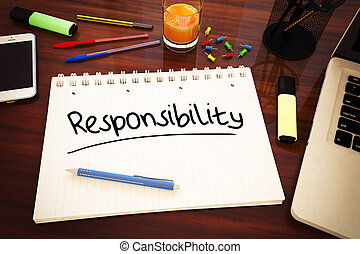 Responsibility - handwritten text in a notebook on a desk -...