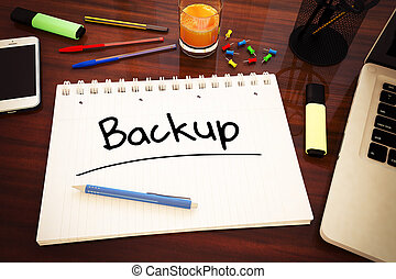 Backup - handwritten text in a notebook on a desk - 3d...