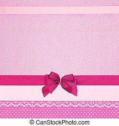 Pink retro polka dot textile background with ribbons and bow