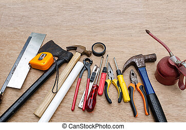set of different tools for work on wood background