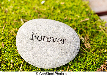 Round stones - Small garden stones engraved with signs.