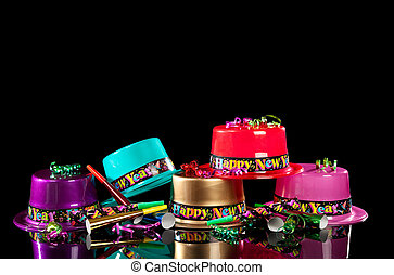New Years\' Eve party hats on black background - Colorful...