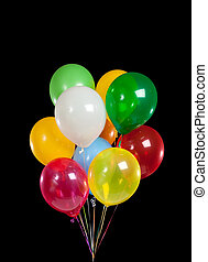 Group of colorful party balloons on black background - A...