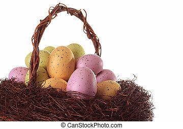 Easter basket with speckled eggs.