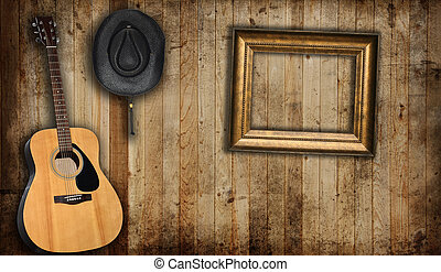Country scene - Cowboy hat, guitar and empty picture frame,...