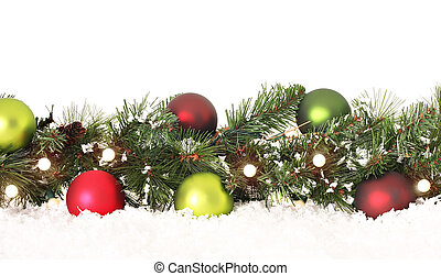 Christmas border of evergreen, ornaments, lights and snow.
