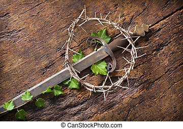 Easter symbols - Crown of thorns and sword symbolizing Jesus...