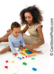 Toddler playing with blocks - Cute African toddler boy...