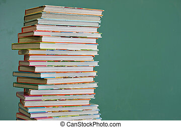 Childrens books - Tall stack of childrens book in a...