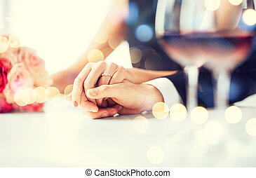 engaged couple with wine glasses - love, family, anniversary...