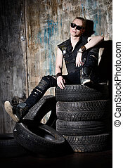 rocker guy - Masculine handsome man in the old garage Rock...