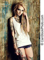 young generation - Modern girl with blonde dreadlocks. Jeans...