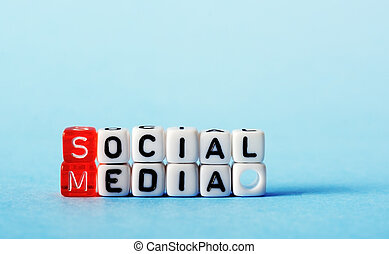 Social Media on red an white dices on blue background