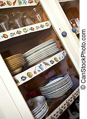 Cupboard - Plates and glasses in a cupboard