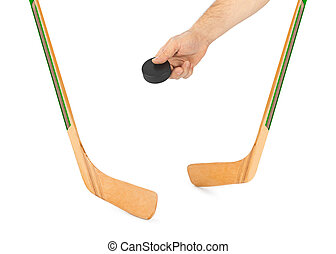 Ice hockey stick and hand with puck