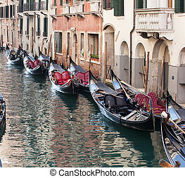 Row of empty gondolas. - Row of empty gondolas parked in the...