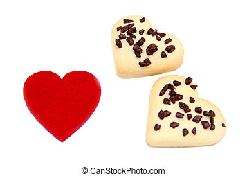 Cookies and little heart red on white background