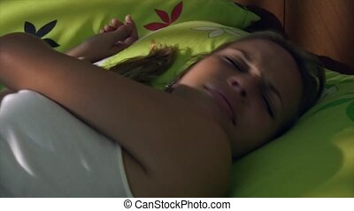 Young Woman In Bed Waking Up - Young lazy woman waking up in...