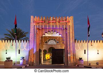 Al Ain palace illuminated at night. Emirate of Abu Dhabi, United Arab Emirates