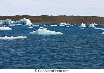 Icebergs floating toward the ocean