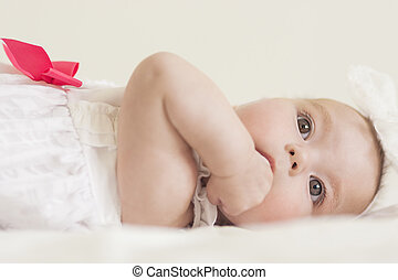 Portrait of Cute Infant Caucasian Female Child Against White...