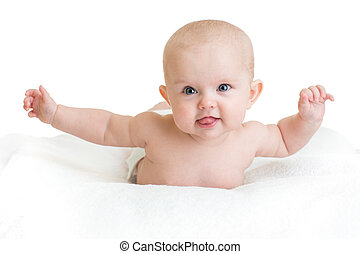 Cute healthy baby lying on white towel with hands up...