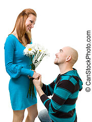 Man giving camomile to woman - Young bold man giving...