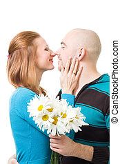 Couple kissig holding flowers - Couple kissig standing...