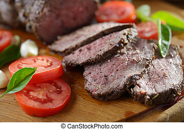 Roast beef - Sliced roast beef and vegetables on a cutting...