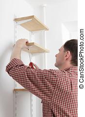 Man installing shelves