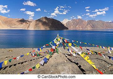 Buddhist prayer flags flying at Pangong Lake, Ladakh, India...